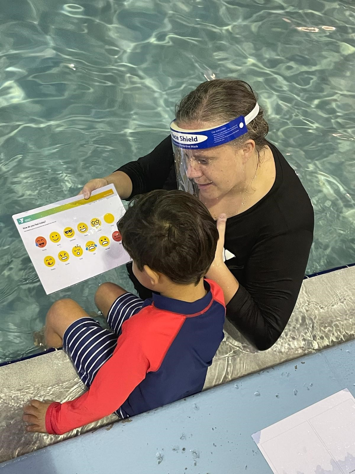 swimming coach and child