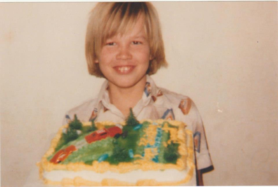 David holding a birthday cake